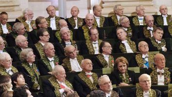 "Members of the French Academy listen to French Simone Veil, an Auschwitz survivor and the first elected president of the European parliament during her official entry ceremony as member of the prestigious Academie Francaise, the guardian of the French language, on March 18, 2010 at the Institut de France in Paris. The 82-year-old Veil, a former French minister who ranks among the country's most respected politicians, is only the sixth woman to join the ""immortals"", as the 40 members of the Academie are known. Dressed in the members' traditional green uniform, designed specially for her by Chanel, Veil was presented with the ceremonial sword bearing the inscription ""Liberty, Equality and Fraternity"". Veil's tattooed Auschwitz prisoner number, 78651, was also engraved on the sword that was presented to her by former president Jacques Chirac during a ceremony at the French Senate. (From R) Jean-Luc Marion, Dominique Fernandez, Pierre Nora. AFP PHOTO POOL PHILIPPE WOJAZER"